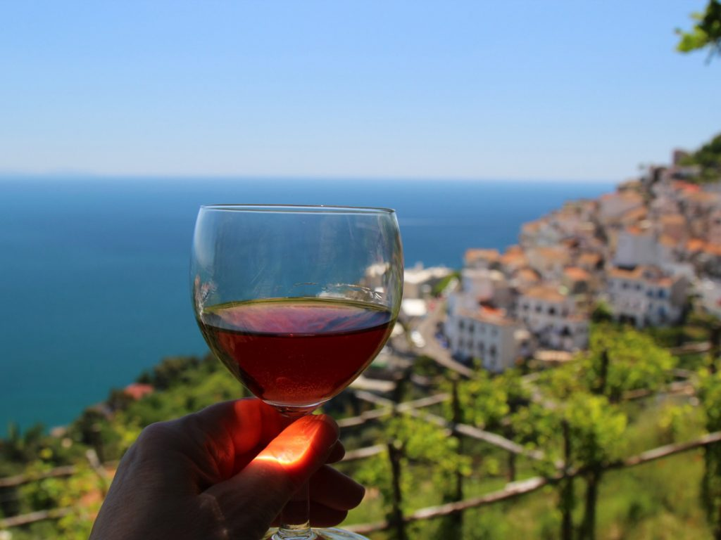 Cheers glass of wine Amalfi Coast Italy Carol Ketelson Delectable Destinations Culinary Tours