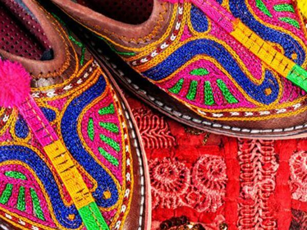 colorful slippers on rug India Carol Ketelson Delectable Destinations Culinary Tours