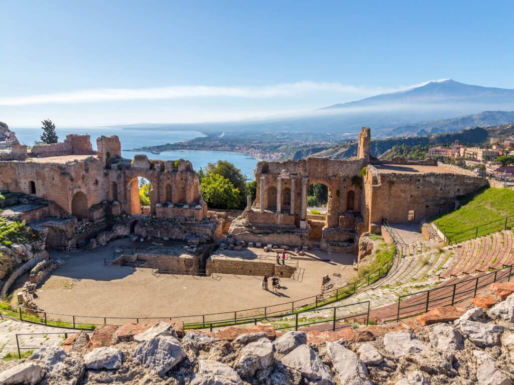 Ancient Theater of Taormina Mount Etna in the background Delectable Destinations and Amalfi Life Amazing Sicily