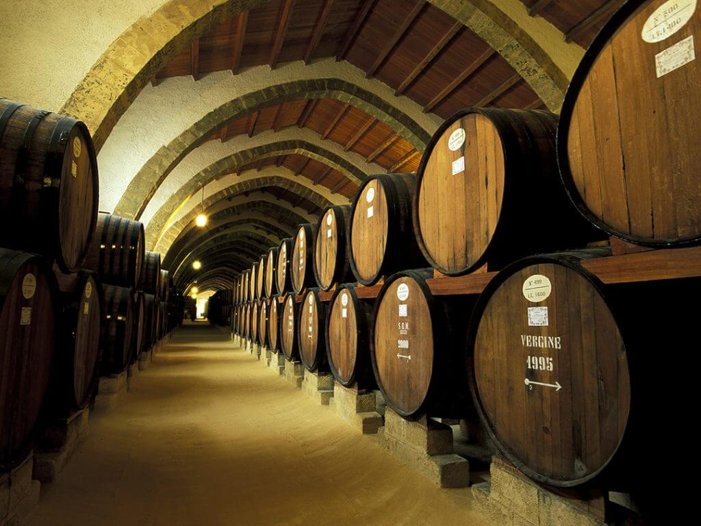 barrels in marsala wine cellar Delectable Destinations Amazing Amalfi Culinary Tour of Sicily