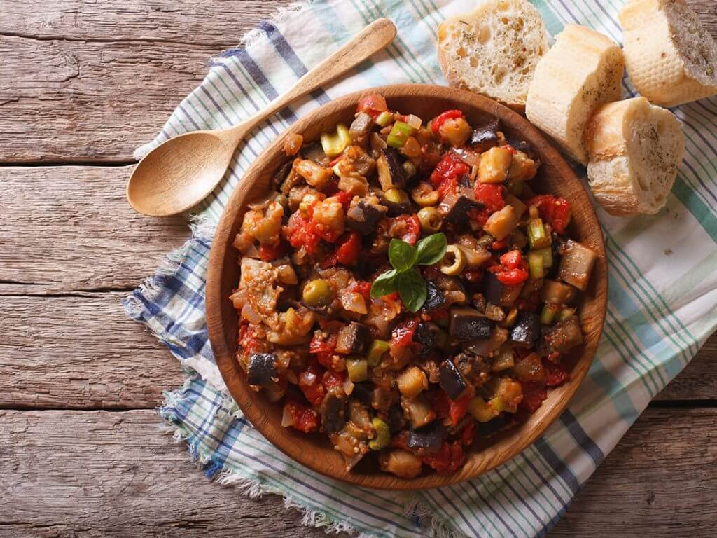 Sicilian Caponata with aubergines wooden plate Delectable Destinations Amazing Amalfi Culinary Tour of Sicily