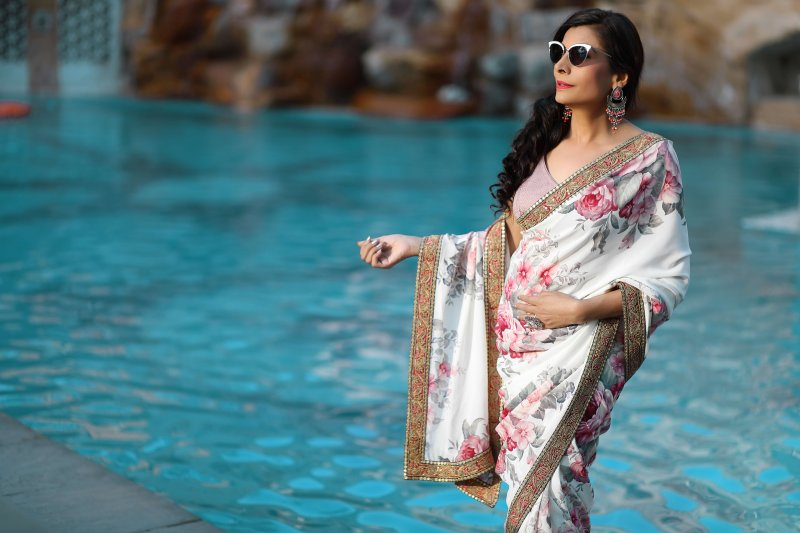 Flowers on white Saree, The Timelessness of the Classic Indian Saree, Delectable Destinations