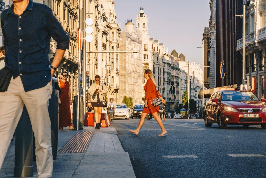 Madrid Gran Via woman crossing street